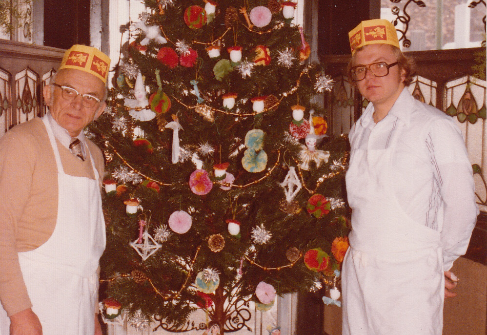 Kramarczuk's founder Wasyl Kramarczuk (left), and his son Orest Kramarczuck (right) pose during the holidays in the 1980s. They are the grandfather and father, respectively, of current general manager Nick Kramarczuk. The tradition of this family business in Minneapolis dates back six decades. (Photo provided: Nick Kramarczuk)